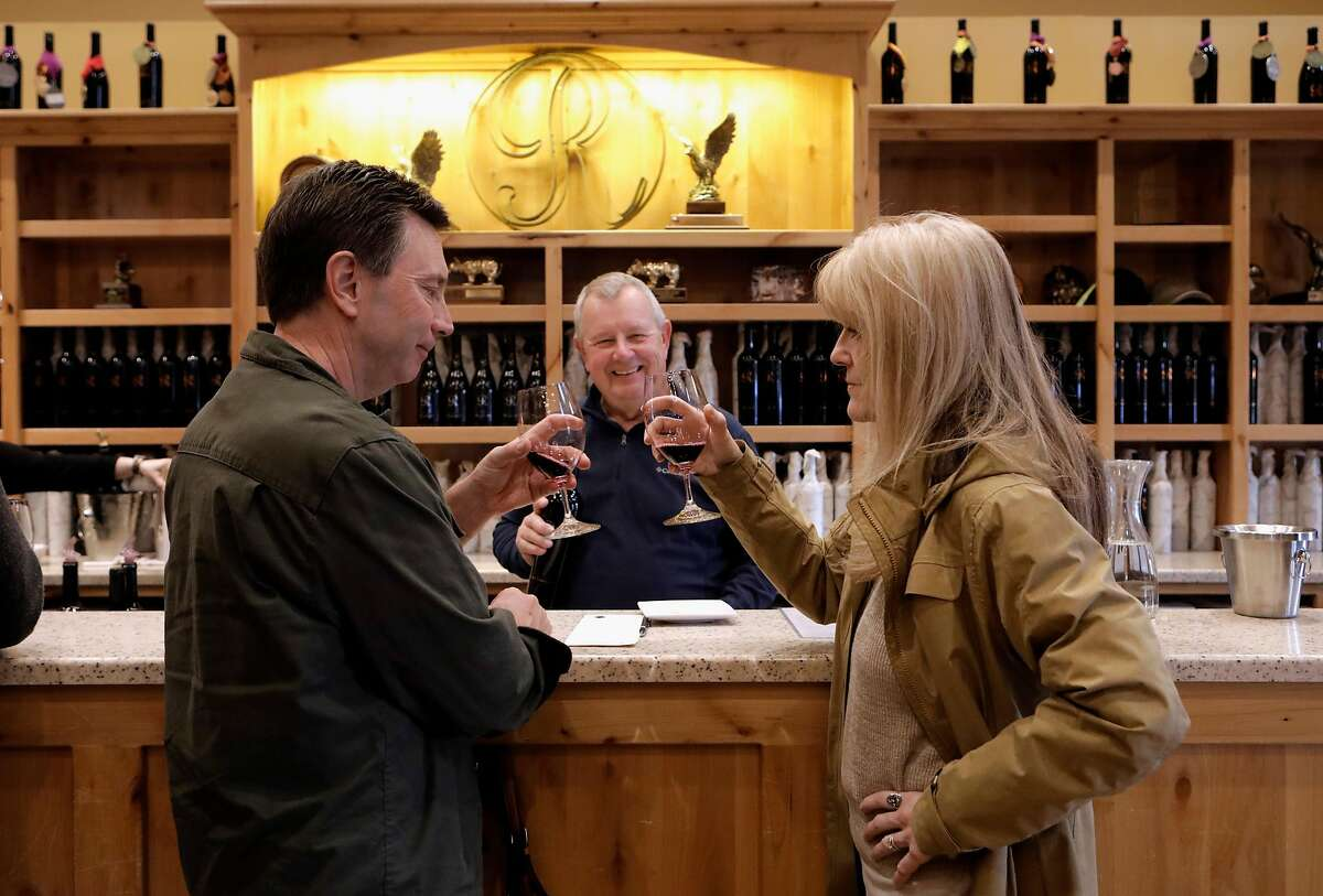 Tasting room associate Bill Schwanki pours wines for Ted and Marlene White at the Jeff Runquist Winery in Plymouth, Ca., on Sat. Feb. 16, 2019.