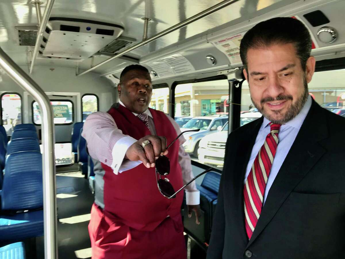 Keith Snelgro, left, shows Harris County Precinct 2 Commissioner Adrian Garcia the features of a Harris County Transit bus on Dec. 18, 2019. The county earlier this month began operating five new transit routes, paid for with disaster recovery funds related to Hurricane Harvey.