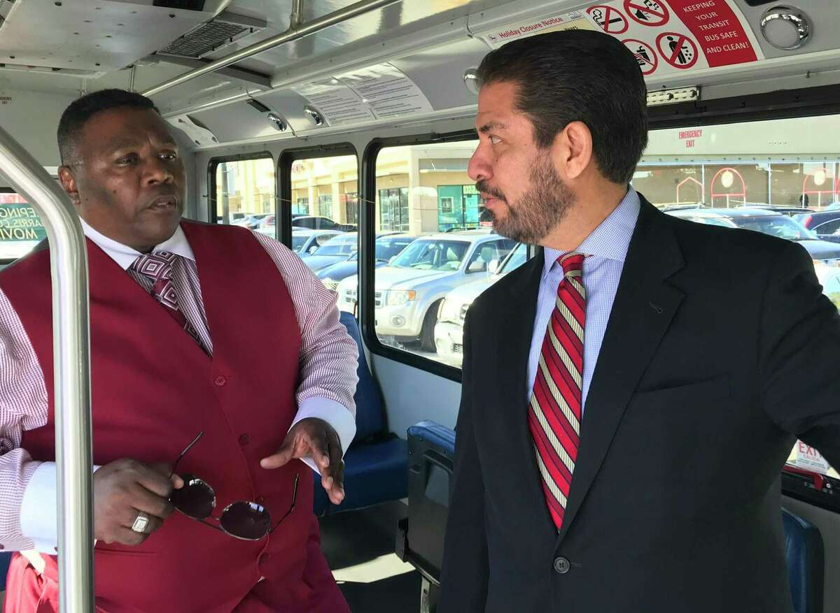 Keith Snelgro, left, shows Harris County Precinct 2 Commissioner Adrian Garcia the features of a Harris County Transit bus on Dec. 18, 2019.