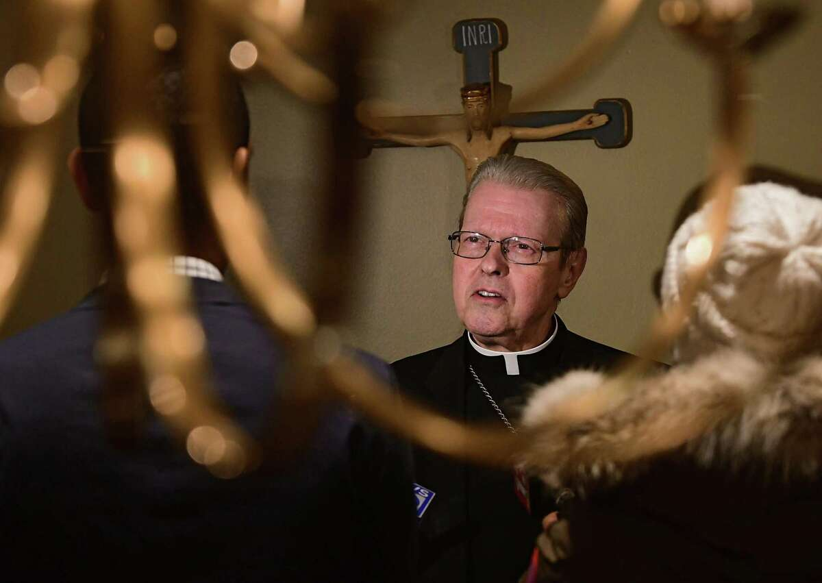 Bishop Edward Scharfenberger is interviewed by the press ahead of a prayer service for sex abuse survivors at the Cathedral of the Immaculate Conception in Albany, N.Y. on Wednesday, Dec. 18, 2019. (Lori Van Buren/Times Union)