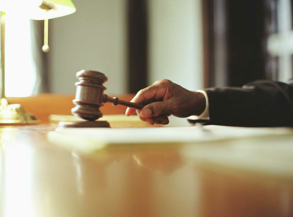 File photo of male judge striking a courtroom gavel.