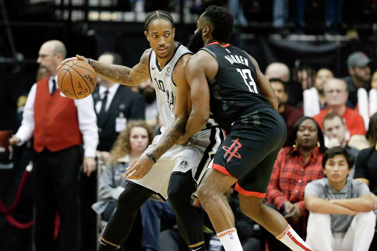 San Antonio Spurs guard DeMar DeRozan, left, dribbles as Houston Rockets guard James Harden defends during the first half of an NBA basketball game, Monday, Dec. 16, 2019, in Houston. (AP Photo/Eric Christian Smith)