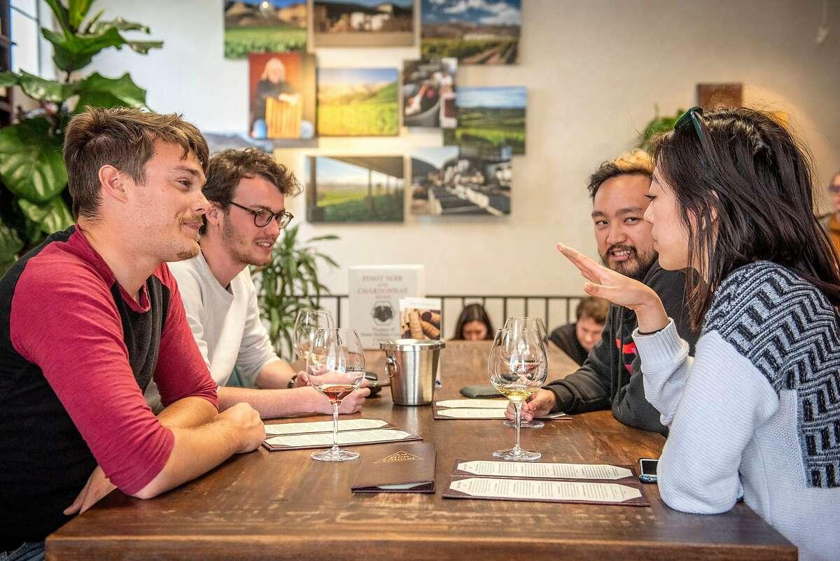 Noah Malik (from left), Ruben Jenssen, Will Moy and Kathy Tran of Santa Barbara at the Au Bon Climat tasting room on Saturday, April 20, 2019, in Santa Barbara, Ca.