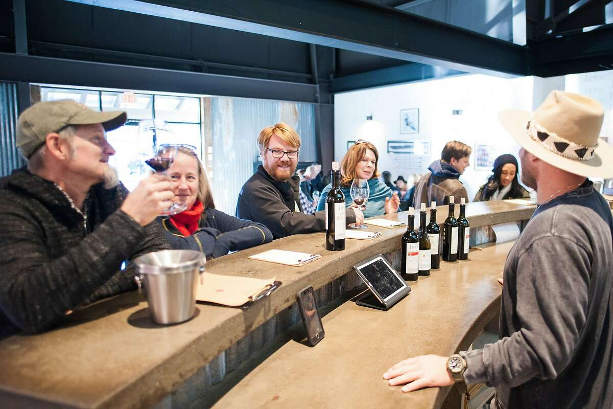 Winemaker Bret Urnes talks with customers at Levo Wine tasting room in Paso Robles, Calif.