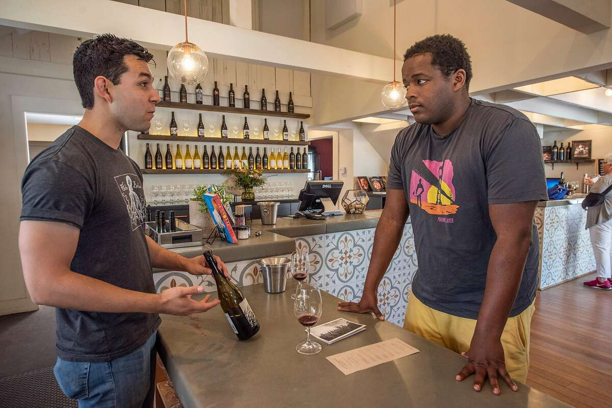 Wine Educator Gabriel Stahl, left, goes over the tasting notes of the 2017 Stolpman Vineyards La Cuadrilla to Bradley Walters of Los Angeles at the Stolpman Vineyards tasting room on Sunday, April 14, 2019, in Los Olivos, Ca.