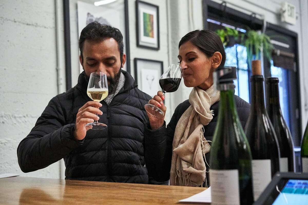 Kinjal and Devika Icecreamwala taste wine at Blue Ox Winery on Saturday, Nov. 30, 2019, in Berkeley, Calif.