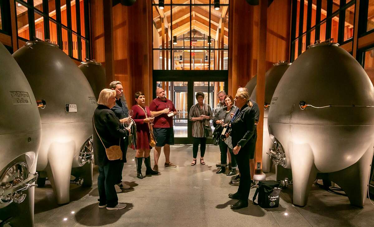 People taste wine in the Concrete Egg Fermentation Hall at Cakebread Cellars in Rutherford, Calif. on November 1st, 2019.