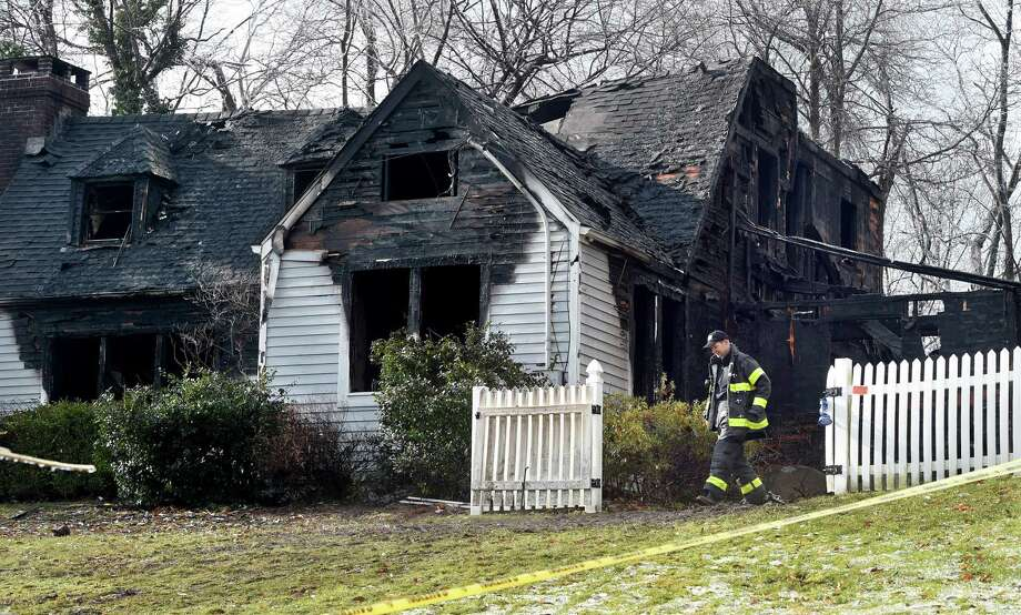The scene of an early morning fire at 612 Chestnut Ridge Road in Orange on December 18, 2019. Photo: Arnold Gold / Hearst Connecticut Media / New Haven Register