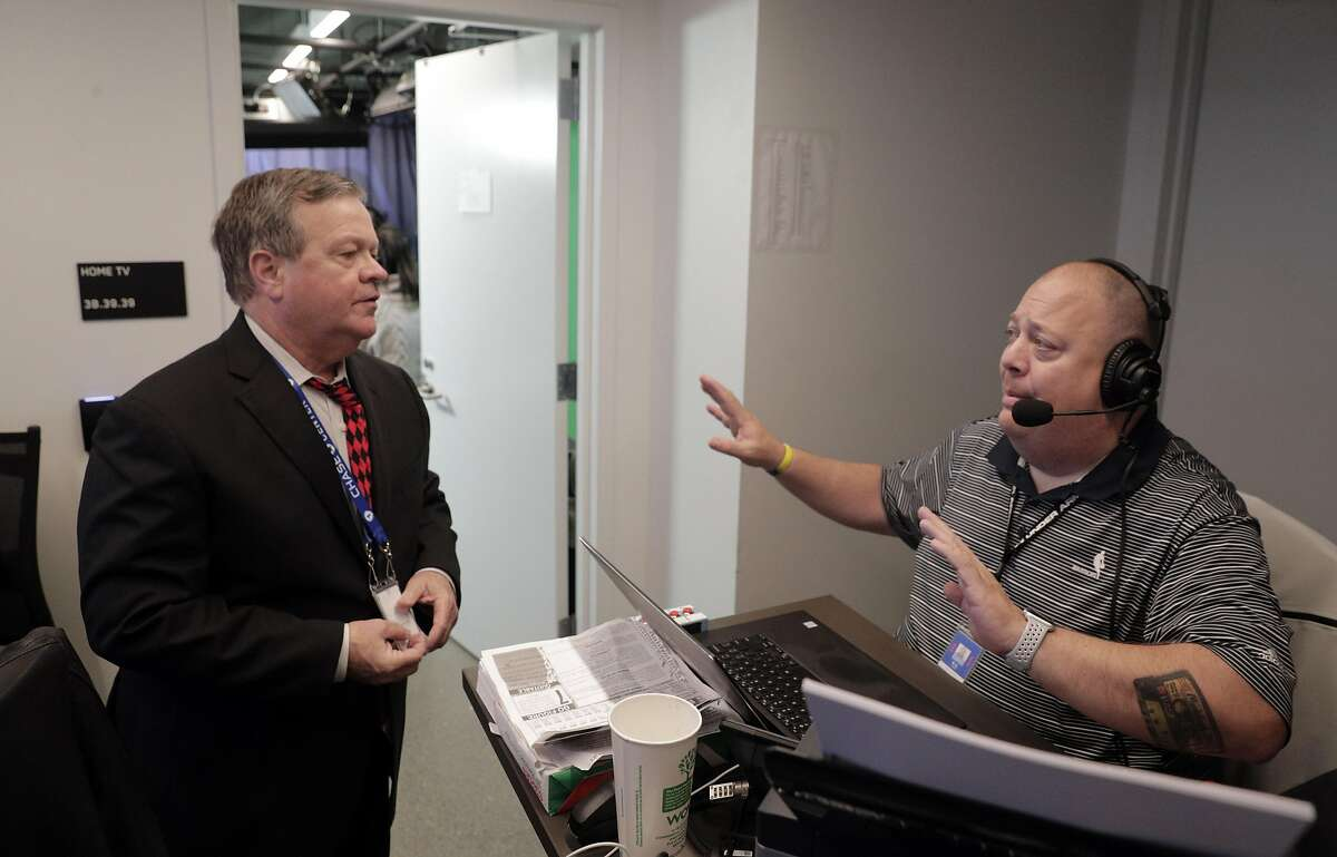 Warriors radio play-by-play announcer Tim Roye, talks with senior broadcast producer, RC Davis as he prepares to call the game between the Warriors and the New York Knicks at Chase Arena in San Francisco, Calif., on Wednesday, December 11, 2019. Roye has been broadcasting Warrior games for 25 years.