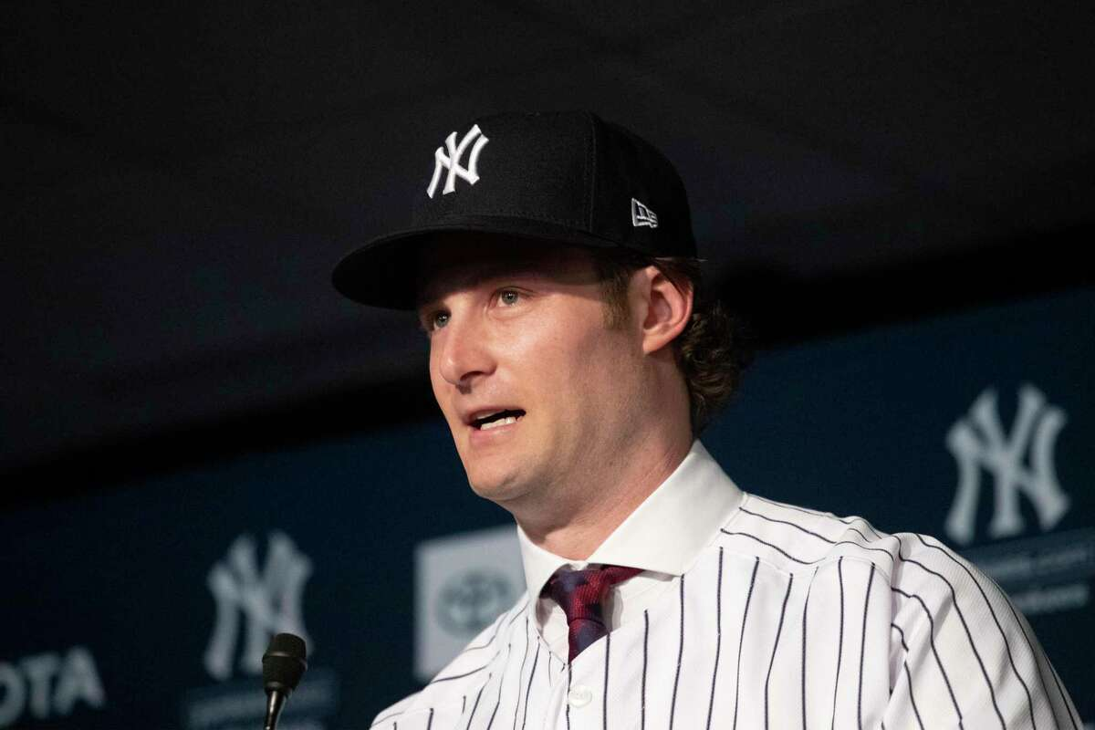 Gerrit Cole is introduced as the newest New York Yankees player during a baseball media availability, Wednesday, Dec. 18, 2019 in New York. The pitcher agreed to a 9-year $324 million contract. (AP Photo/Mark Lennihan)