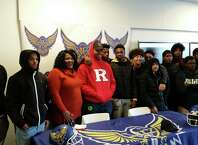 Harding senior lineman Troy Rainey poses with his mother, Portia, and his teammates after he signed his National Letter of Intent to play football at Rutgers. The ceremony was held at the school in Bridgeport, Conn., on Dec. 18, 2019.