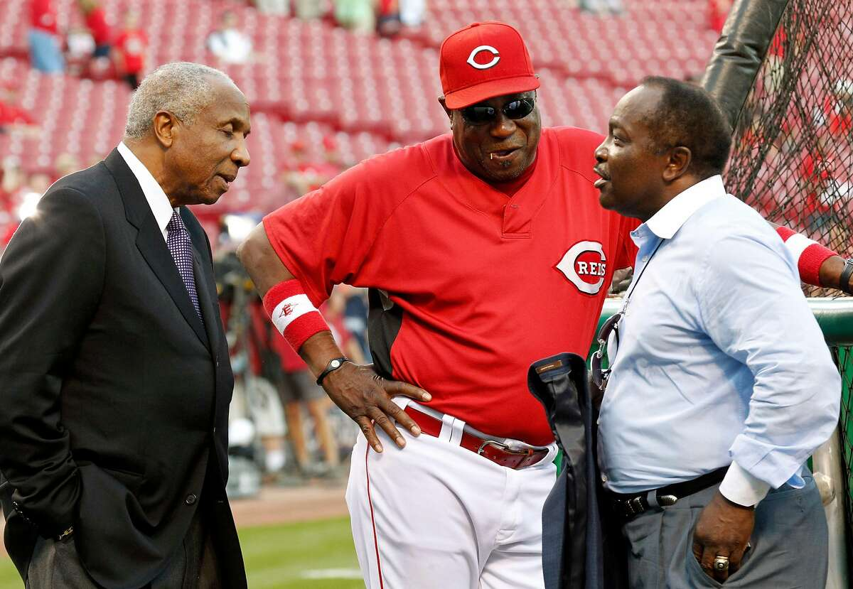 Joe Morgan, right, has a pregame chat with Reds manager Dusty Baker, center, and fellow Hall of Famer Frank Robinson before a 2010 NLDS game in Cincinnati. Morgan died Sunday at the age of 77.
