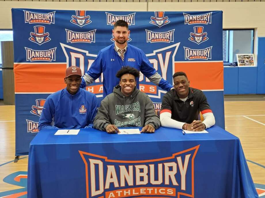 Jah Joyner (Minnesota), left, is joined by Kile Jackson (Wagner) and Pierre Moudourou (Utah), who all signed their letters of intent to play college football on Wednesday. Moudourou graduated from Danbury in 2016 and is heading to Utah from Monroe College in New York. Photo: Contributed Photo