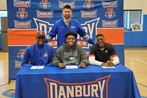 Jah Joyner (Minnesota), left, is joined by Kile Jackson (Wagner) and Pierre Moudourou (Utah), who all signed their letters of intent to play college football on Wednesday. Moudourou graduated from Danbury in 2016 and is heading to Utah from Monroe College in New York.