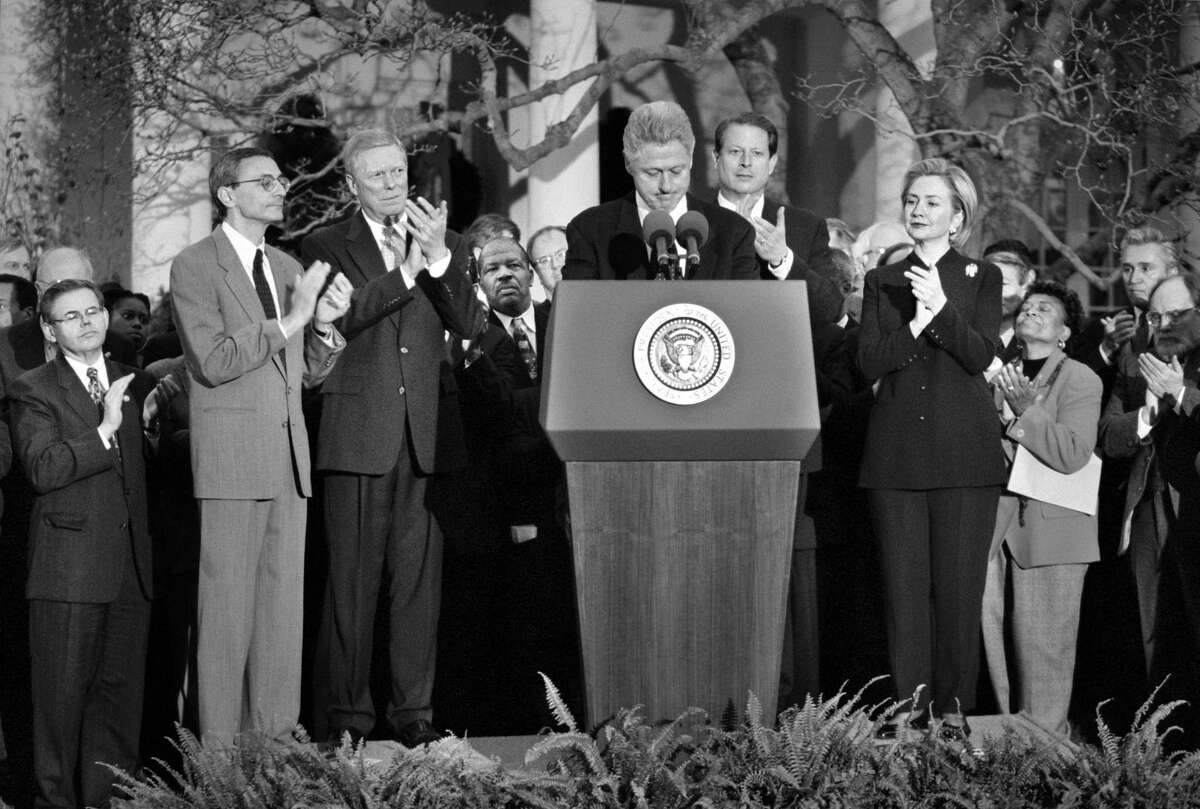 President Bill Clinton is applauded after reading a statement outside the Oval Office Dec. 19, 1998, the day the House of Represenatives voted to impeach him.