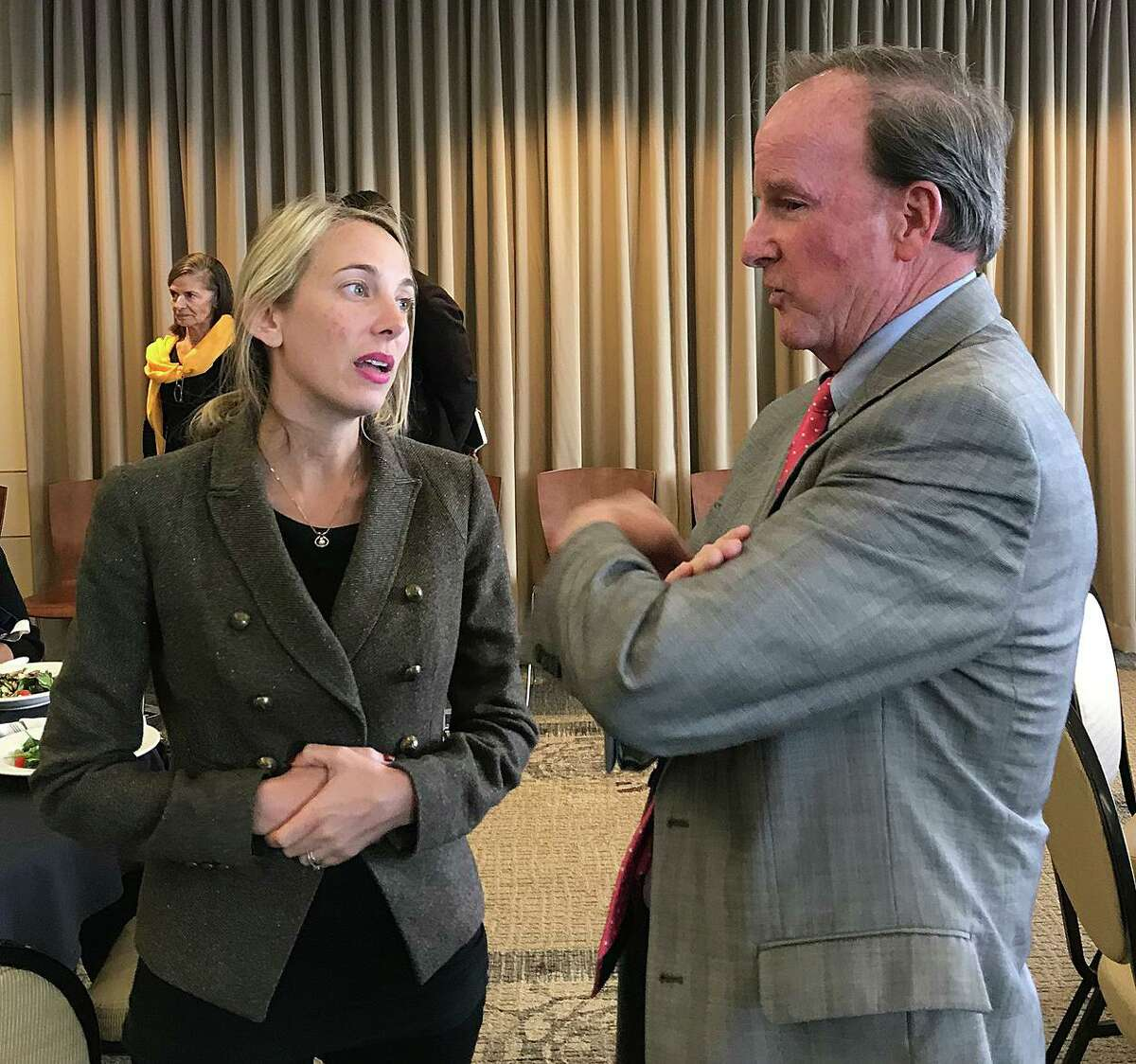 Council member-elect Abbie Kamin, who will represent District C, chats with District E Councilmember Dave Martin during the second day of orientation for the newly elected council members on Tuesday, Dec. 17, 2019, in a conference room at the George R. Brown Convention Center.