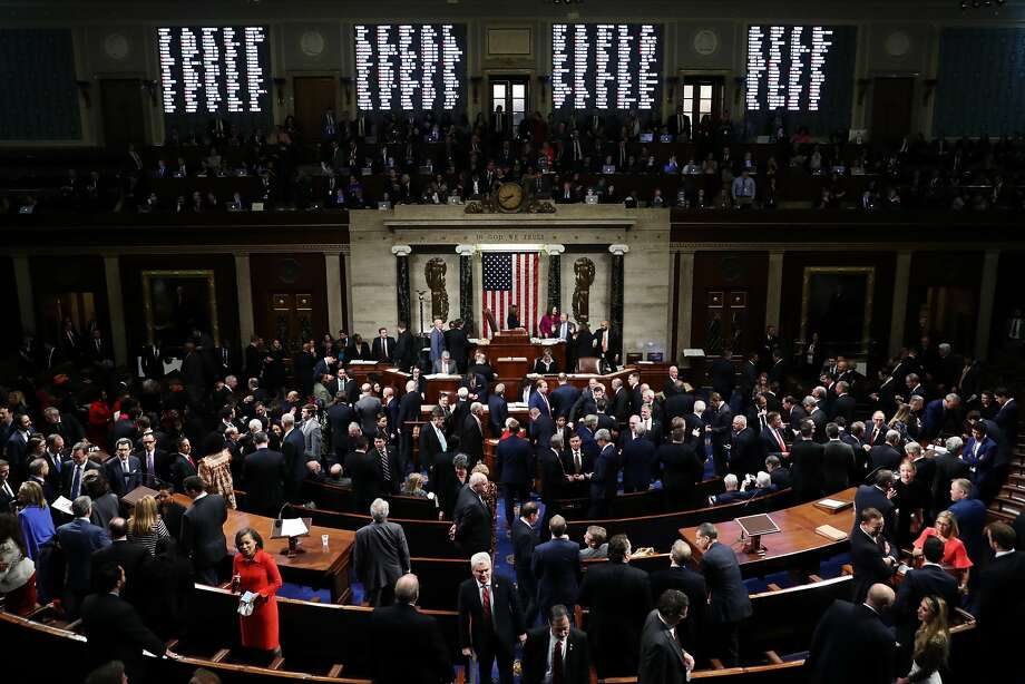 WASHINGTON, DC - DECEMBER 18: The House of Representatives votes on the second article of impeachment of US President Donald Trump at in the House Chamber at the US Capitol Building on December 18, 2019 in Washington, DC. The U.S. House of Representatives voted to successfully pass two articles of impeachment against President Donald Trump on charges of abuse of power and obstruction of Congress. (Photo by Chip Somodevilla/Getty Images) Photo: Chip Somodevilla, Getty Images