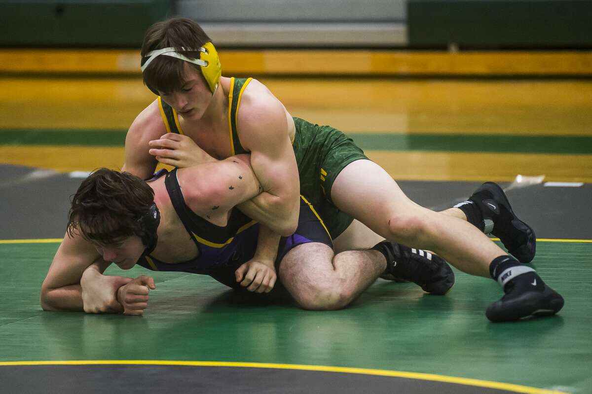 Dow's Aidan Wardell wrestles an opponent from Bay City Central during a quad meet Wednesday,Dec. 18, 2019 at H. H. Dow High School. (Katy Kildee/kkildee@mdn.net)