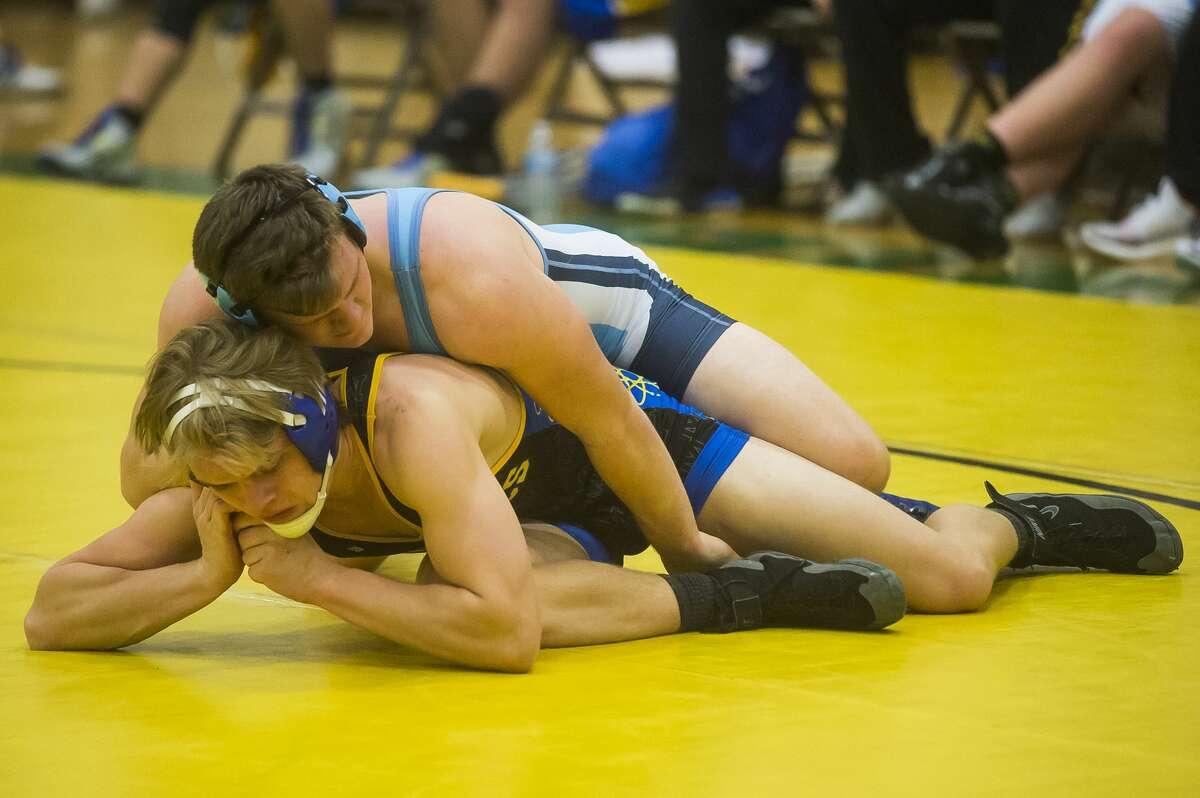 Midland's John Hine wrestles an opponent from Essexville Garber during a quad meet Wednesday,Dec. 18, 2019 at H. H. Dow High School. (Katy Kildee/kkildee@mdn.net)