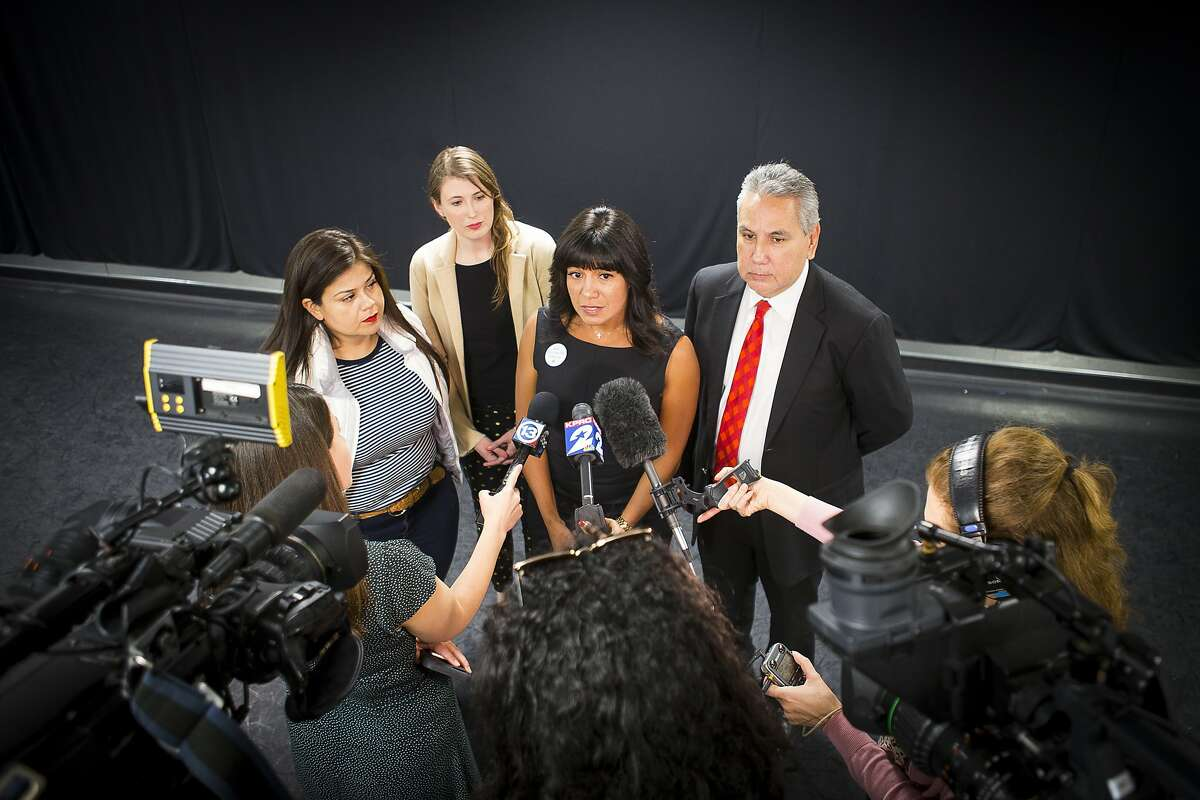 Houston Independent School District board of trustees president Diana Dávila (center) is joined by board members Elizabeth Santos, Holly Maria Flynn Vilaseca and Sergio Lira talk with reporters regarding the news Monday that the Texas Education Agency's state-appointed conservator ordered the board to suspend their search for a permanent superintendent, Monday, March 25, 2019 at Talento Bilingue De Houston.