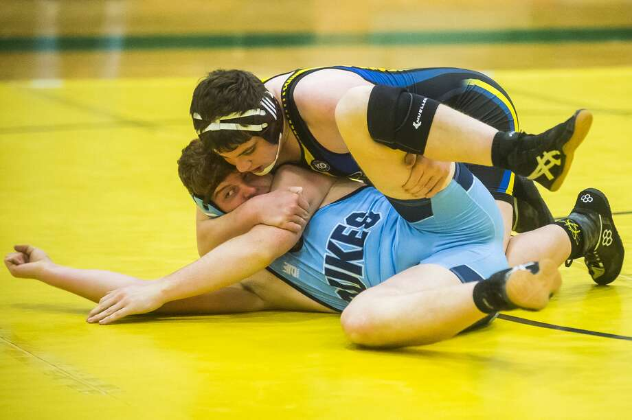 Midland's Wilson Shinske wrestles an opponent from Essexville Garber during a quad meet Wednesday, Dec. 18, 2019 at H. H. Dow High School. (Katy Kildee/kkildee@mdn.net) Photo: (Katy Kildee/kkildee@mdn.net)