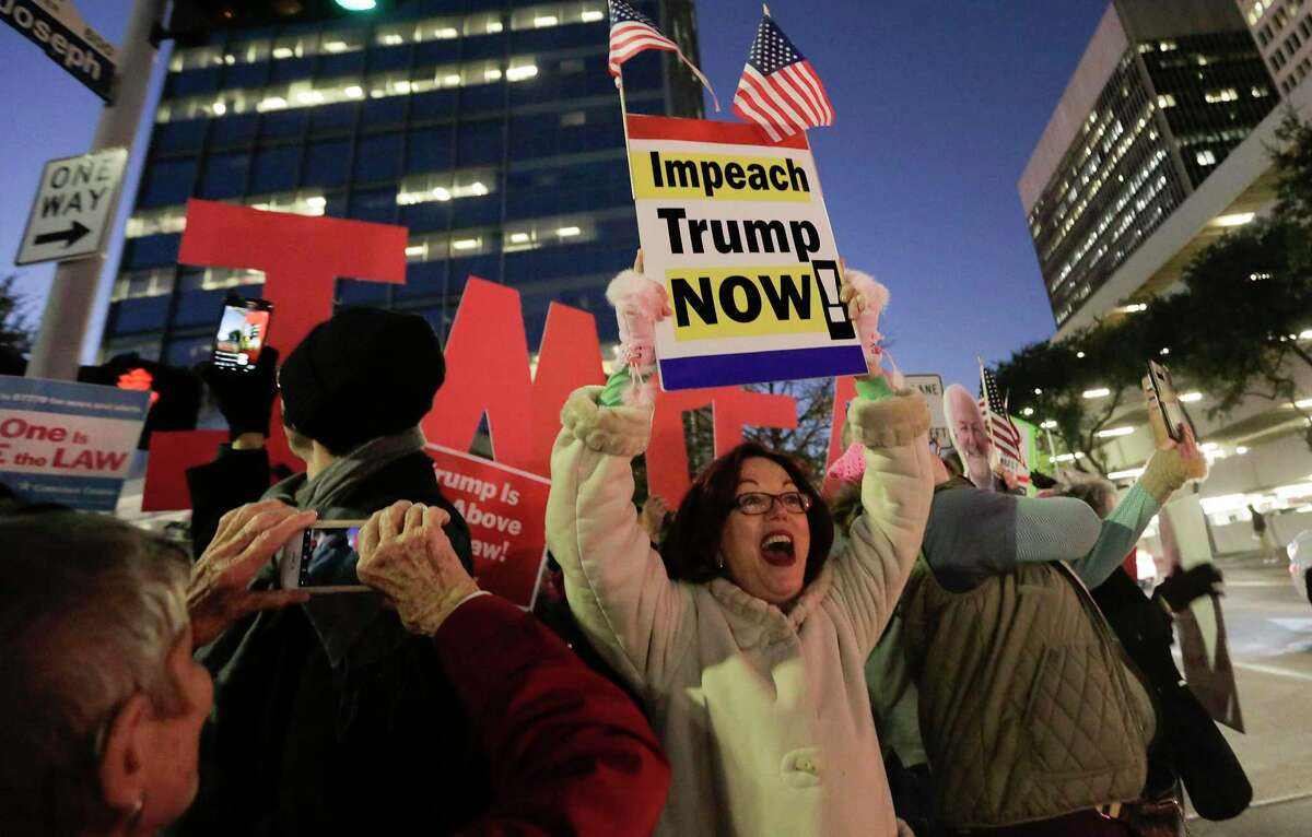 Houstonians gather outside the office of U.S. Sen. Ted Cruz as part of a national protest in support of impeachment on Tuesday, Dec. 17, 2019 in Houston.