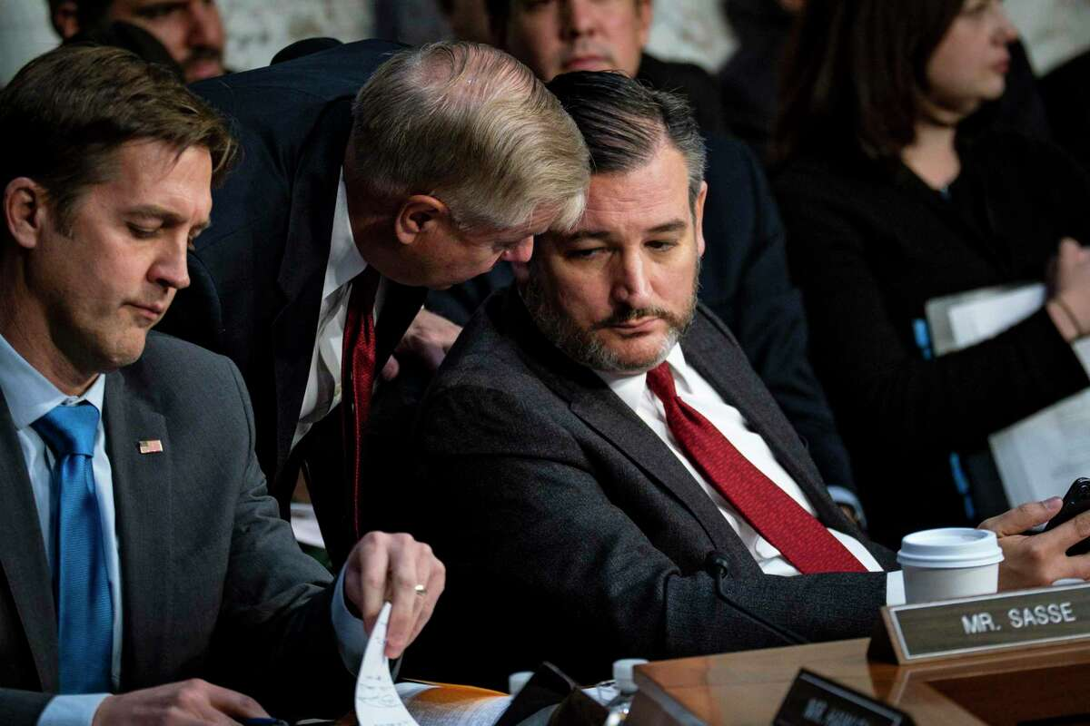 Senate Judiciary Committee Chairman Lindsey Graham (R-S.C.) confers with Sen.Ted Cruz (R-Texas) as Michael Horowitz, the inspector general of the Justice Department, testifies before the committee in Washington on Wednesday, Dec. 11, 2019. Horowitz detailed his lengthy report on the Russia investigation and why a prosecutor also examining the inquiry disagreed with a key finding. (Pete Marovich/The New York Times)