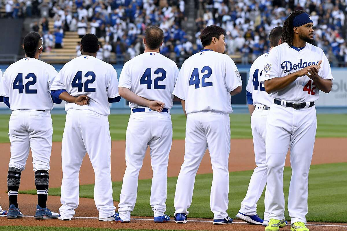 LOS ANGELES, CALIFORNIA - APRIL 15: Kenley Jansen #42 of the Los Angeles Dodgers lines up for the National Anthem before the game against the Cincinnati Reds on Jackie Robinson Day at Dodger Stadium on April 15, 2019 in Los Angeles, California. All players are wearing the number 42 in honor of Jackie Robinson Day. (Photo by Harry How/Getty Images)