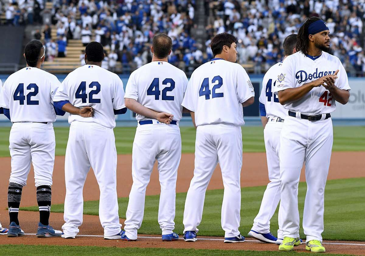 LOS ANGELES, CALIFORNIA - APRIL 15: Kenley Jansen #42 of the Los Angeles Dodgers lines up for the National Anthem before the game against the Cincinnati Reds on Jackie Robinson Day at Dodger Stadium on April 15, 2019 in Los Angeles, California. All playe