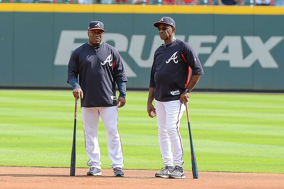 ATLANTA, GA OCTOBER 08: Atlanta Braves first base coach Eric Young, Sr. (left) and third base coach Ron Washington (right) talk things over during batting practice prior to the start of the Major League baseball NLDS game between the Atlanta Braves and the Los Angeles Dodgers on October 8th, 2018 at SunTrust Park in Atlanta, GA. (Photo by Rich von Biberstein/Icon Sportswire via Getty Images)