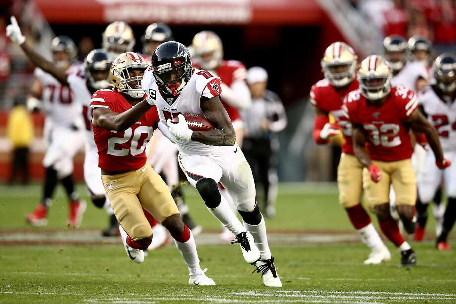 SANTA CLARA, CALIFORNIA - DECEMBER 15: Wide receiver Julio Jones #11 of the Atlanta Falcons carries the ball against free safety Jimmie Ward #20 of the San Francisco 49ers during the game at Levi's Stadium on December 15, 2019 in Santa Clara, California. (Photo by Ezra Shaw/Getty Images) Photo: Ezra Shaw, Getty Images