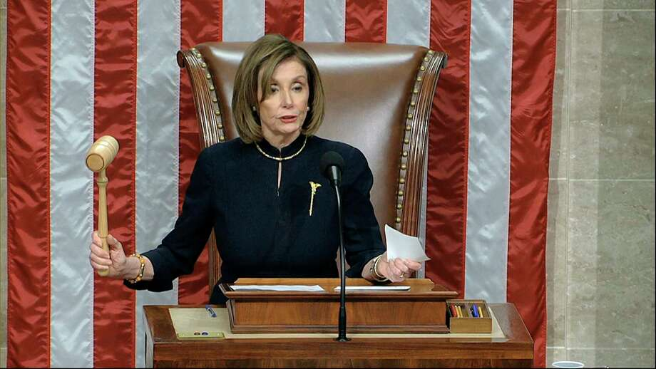 House Speaker Nancy Pelosi of Calif., announces the passage of the second article of impeachment, obstruction of Congress, against President Donald Trump by the House of Representatives at the Capitol in Washington, Wednesday, Dec. 18, 2019. (House Television via AP) Photo: Associated Press / Copyright 2019 The Associated Press. All rights reserved.