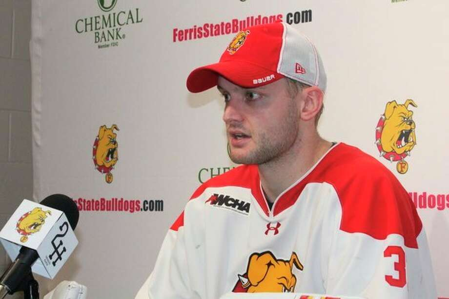 Austin Shaw answers questions at a press conference following Saturday's game. (Pioneer photo/John Raffel)