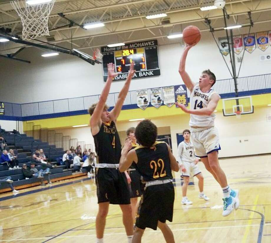 Mohawk junior Justin Cranney takes to the air while attempting a lay-up during Morley Stanwood's 57-38 win over Tri County on Wednesday. (Pioneer photo/Joe Judd)