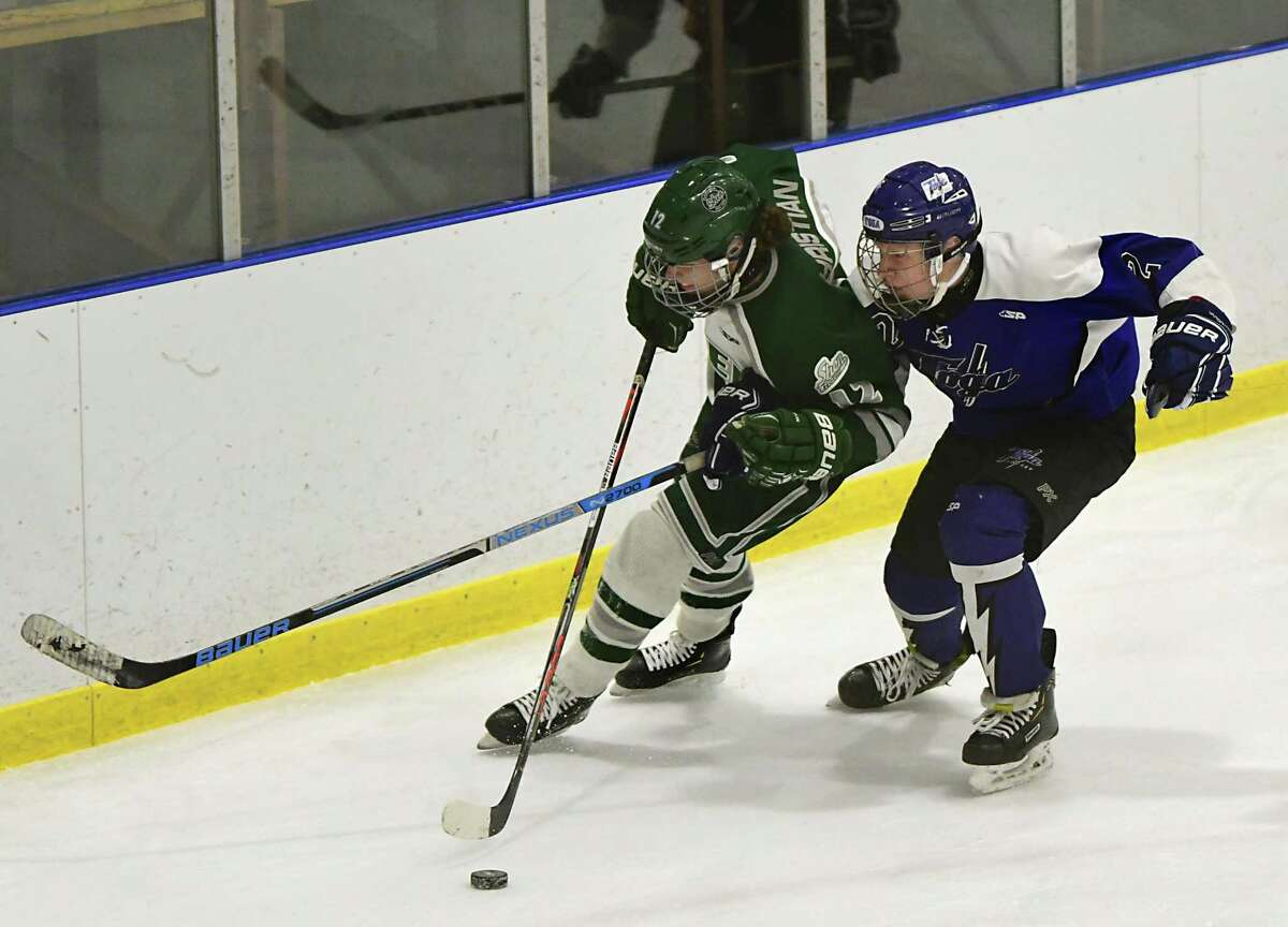 Shenendehowa's Jack Christian, left, and Saratoga's Joseph Mergen battle for the puck during a hockey game on Wednesday, Dec. 18, 2019 in Clifton Park, N.Y. (Lori Van Buren/Times Union)
