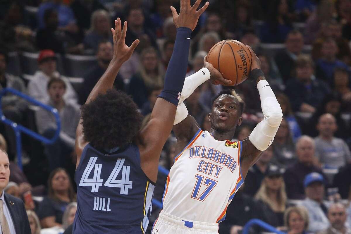 Oklahoma City Thunder guard Dennis Schroder shoots as Memphis Grizzlies forward Solomon Hill (44) defends in the first half of an NBA basketball game Wednesday, Dec. 18, 2019, in Oklahoma City. (AP Photo/Sue Ogrocki)