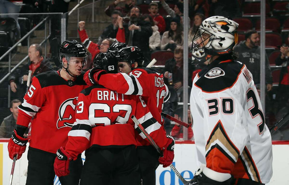 NEWARK, NEW JERSEY - DECEMBER 18: The New Jersey Devils celebrate a goal by Nico Hischier #13 against Ryan Miller #30 of the Anaheim Ducks at 1:28 of the second period at the Prudential Center on December 18, 2019 in Newark, New Jersey. (Photo by Bruce Bennett/Getty Images)