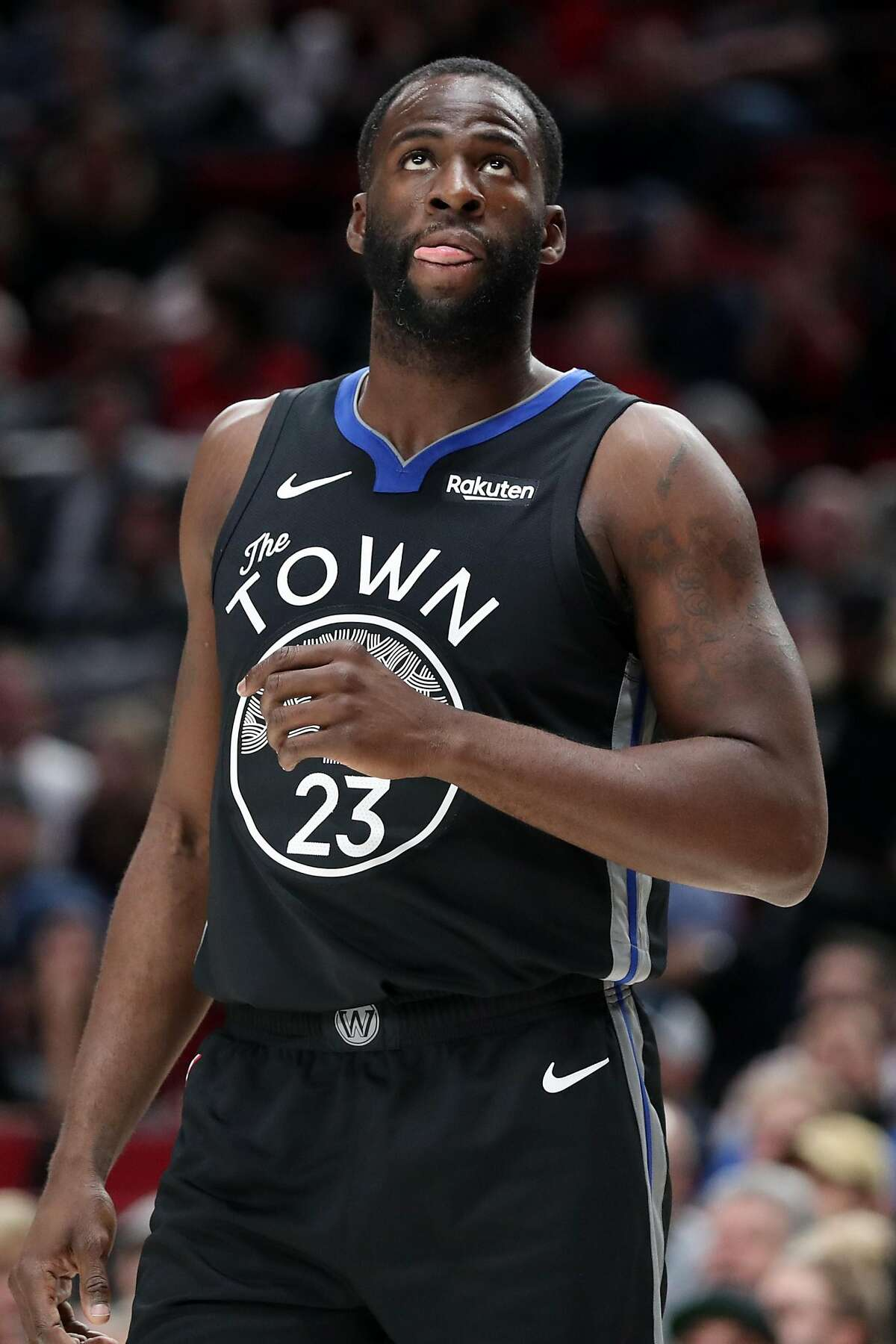 Draymond Green #23 of the Golden State Warriors reacts in the first quarter against the Portland Trail Blazers during their game at Moda Center on December 18, 2019 in Portland, Oregon.