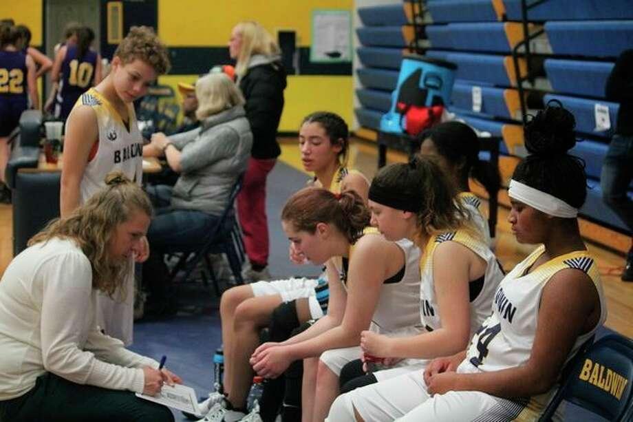 Baldwin girls coach Nikki Bergman (left) designs a play for the team during a recent game. (Star photo/John Raffel)