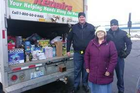 "Lisa Clark, Family Life Service director at ECHO His Love, accepts donations of toys, gifts and food items earlier this month, during the annual ""Stuff a Blue Goose"" event. (Courtesy Photo/Lisa Clark)"