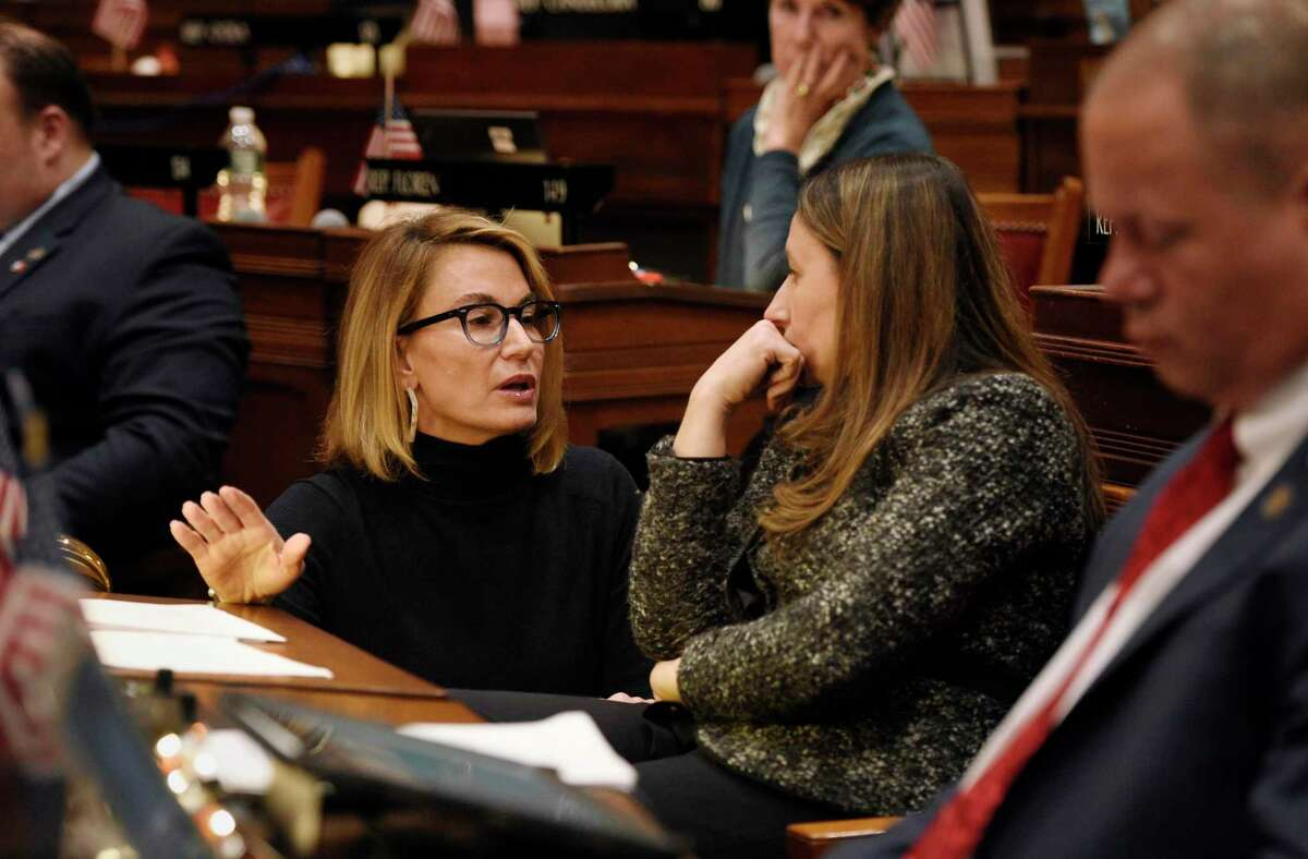 Connecticut House Minority Leader Themis Klarides, R-Derby, left, talks with state Rep. Rosa C. Rebimbas, R-Naugatuck during special session at the State Capitol in Hartford, Conn., Wednesday, Dec. 18, 2019.