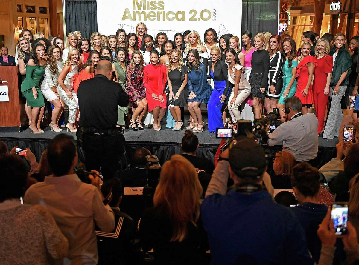 FILE - In this Thursday, Dec. 12, 2019, file photo, candidates for Miss America 2020 pose for a group photo during the official Arrival Ceremony for the Miss America 2.0 competition at Mohegan Sun. Miss America will be crowned for the first time at a tribal casino in Connecticut on Thursday, Dec. 19, 2019. (Sean D. Elliot/The Day via AP, File)