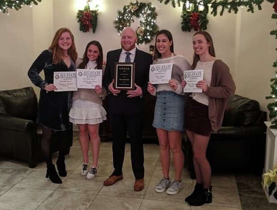 Trumbull High's head swim coach Bill Strickland was named Girl's Swim Coach of the Year. He was recognized, as were All-State awardees Lauren Walsh, Ashleigh Piro, Mia Zajac, and Julia Nevins, at the All State Awards Banquet on Wednesday, Dec. 18. Photo: Contributed Photo / Trumbull High Athletics / Trumbull Times