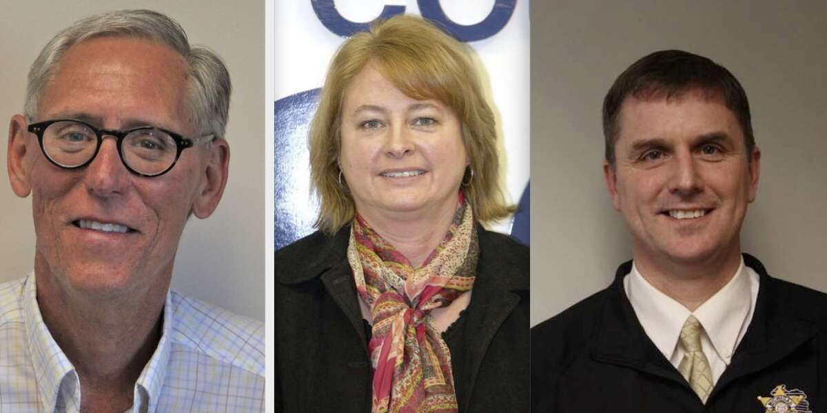 From left, Russell Pomeroy, Jill Nowak and John O'Hagan were among the many employees or officials recently recognized by the Manistee County Board of Commissioners for their years of service to the community.