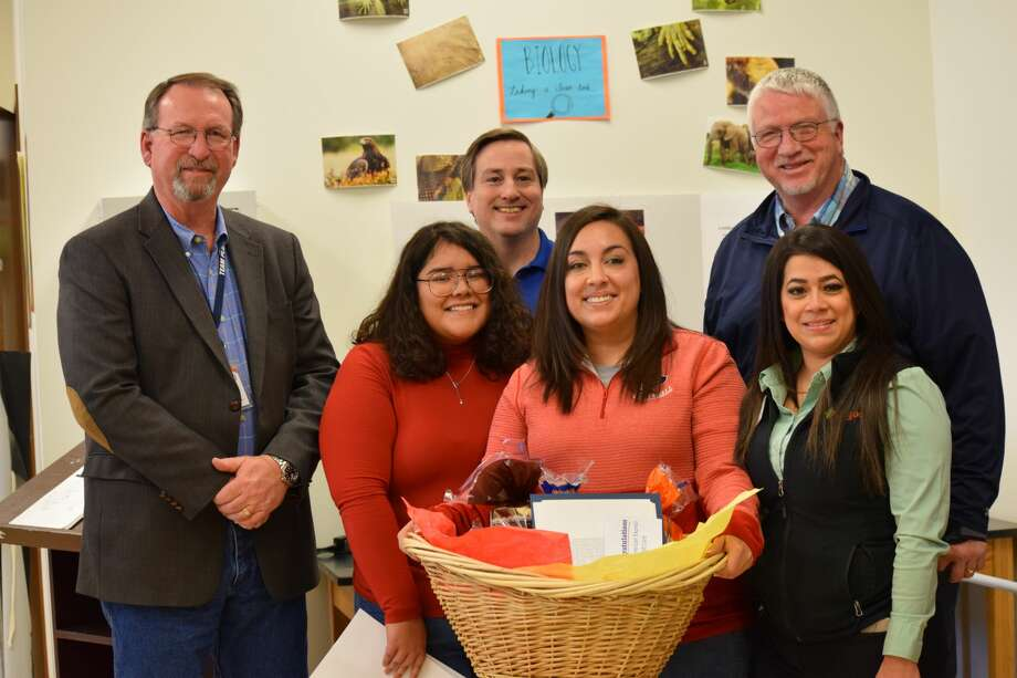 Amanda Martin was recognized Wednesday as a November 2019 Teacher on the Rise. Pictured: (back, L-R) Plainview HS Principal Brandt Reagan, Teachers on the Rise Coordinator Shane Sumrow, Brian Hill, with Amarillo Custom Box Company; (front, L-R) Micah Vega, PHS student, Amanda Martin and Rebekah Bernal, with Amigo's Supermarket Photo: Ellysa Harris/Plainview Herald