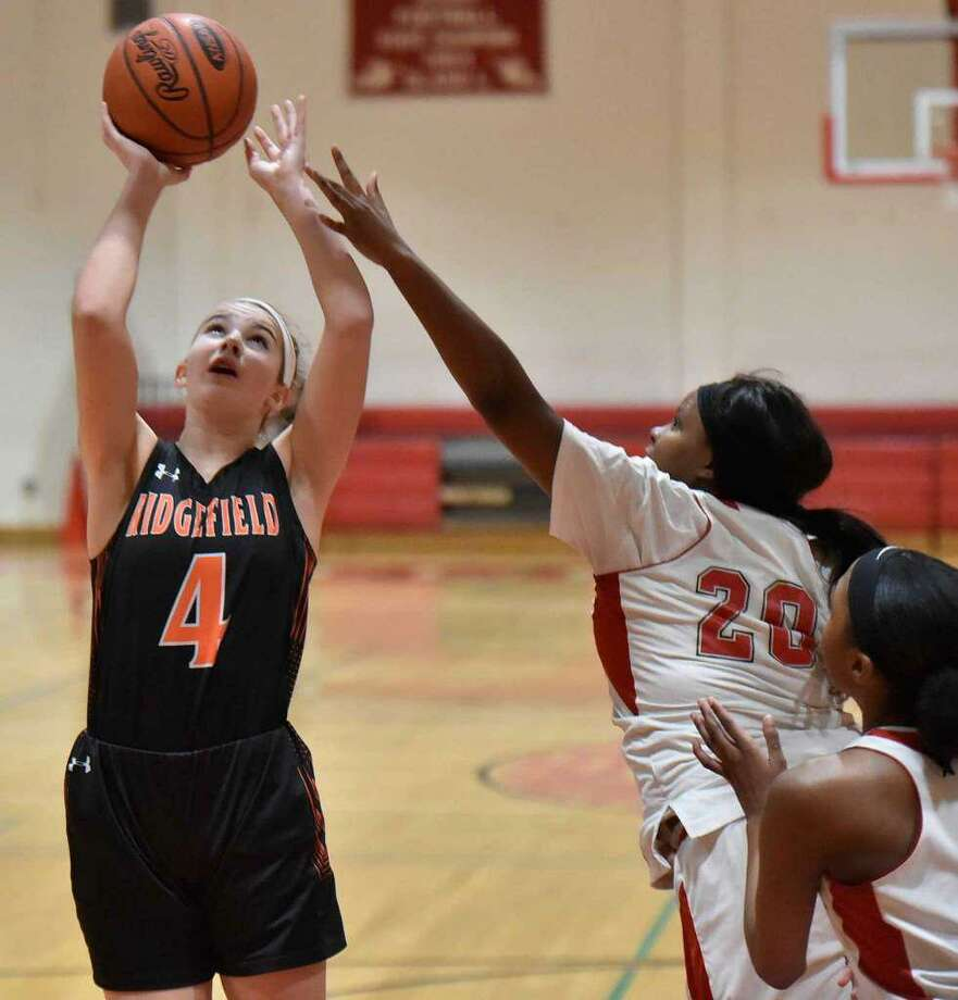 Katie Flynn (shown in a game last season) scored 19 points to help Ridgefield beat Lauralton Hall on Wednesday night in Milford. Photo: Peter Hvizdak / Hearst Connecticut Media