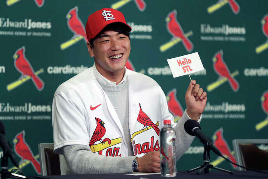 Cardinals pitcher Kwang-Hyun Kim smiles as he holds up a sign during a news conference Tuesday in St. Louis. The Cardinals have signed the Korean left-hander to a two-year contract. Photo: Associated Press