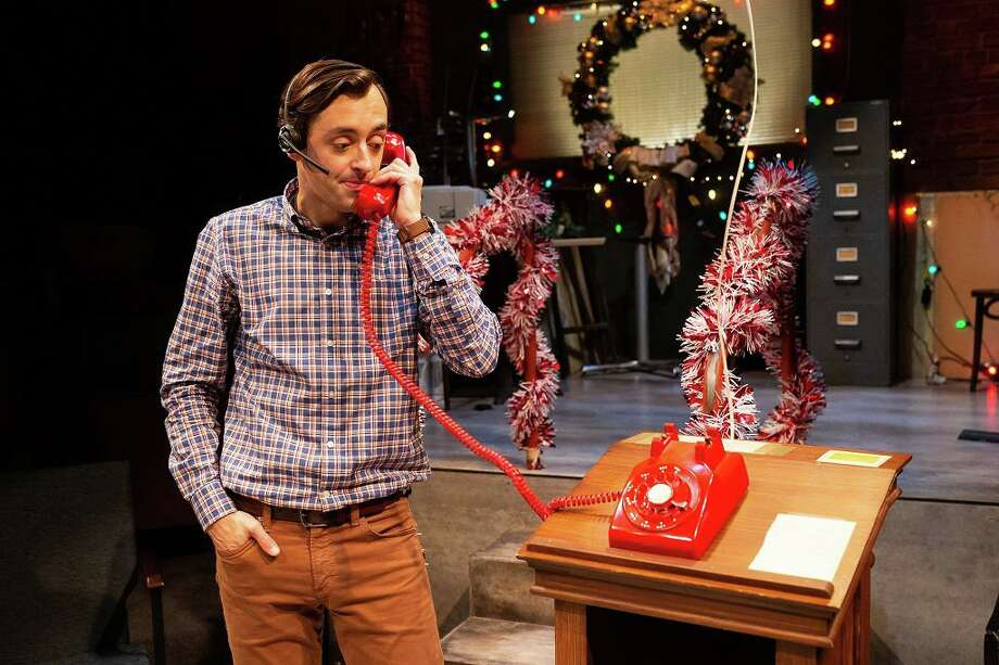 Dylan Godwin, a member of the Alley's resident company, is Sam as well as the over 40 voices on his never-known-a-Silent-Night barrage of phone lines, flooding him with complaints, requests, seductions, demands, and useless advice. Photo: Photo By Lynn Lane
