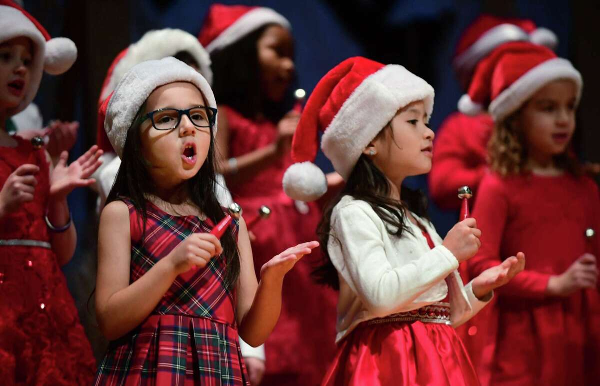 First-grader Parker Rosa and Penelope Mendoza help sing Merry Christmas Bells as All Saints Catholic School holds its annual Christmas concert, Thursday, December 19, 2019, at the school in Norwalk, Conn.