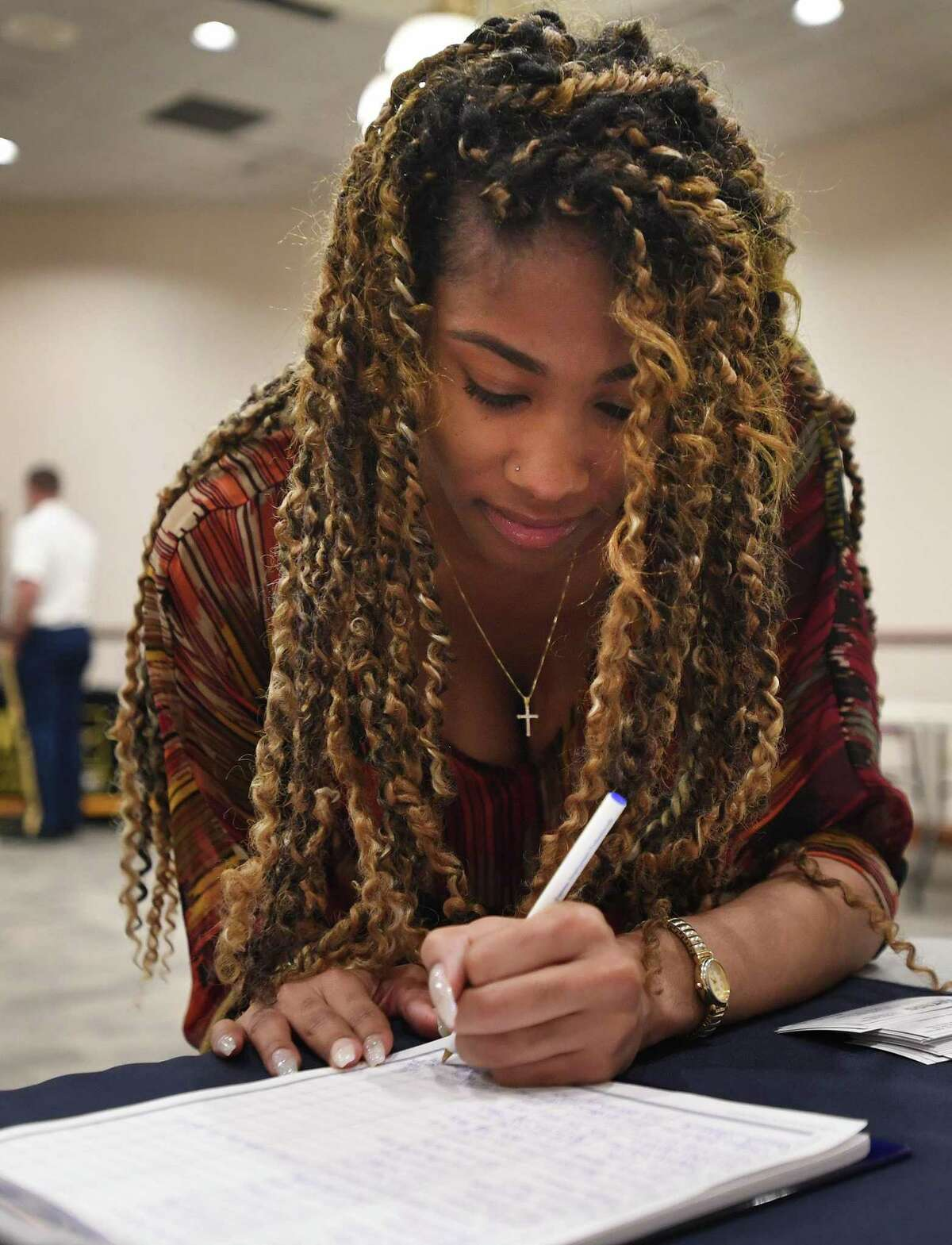 Viviana Johnson, of Bridgeport, applies for jobs at a job fair for youth ages 16 to 21 at the Margaret Morton Government Center in Bridgeport, Conn. on Wednesday, June 26, 2019. Connecticut has gained 13,300 jobs in the past year, including 4,000 in February 2020.